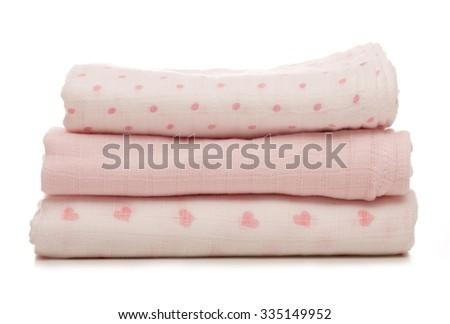 three pink baby muslins cutout - stock photo