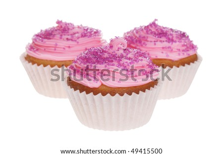 Three pink cupcakes isolated on a white background.