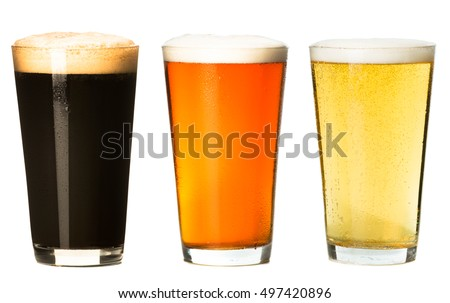 Three pints of beer on white