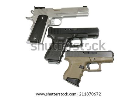 three pistols on white background  - stock photo