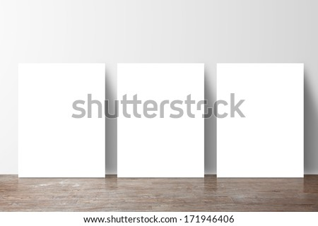three  placard standing next to a gray wall - stock photo