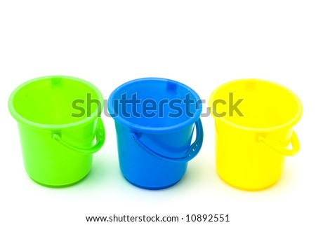 Three plastic buckets isolated on a white background - stock photo