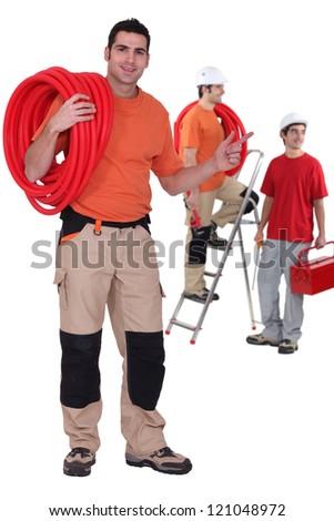 Three plumbers - stock photo