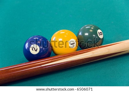 Three pool balls and a stick.