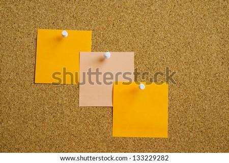Three post it on cork board - stock photo