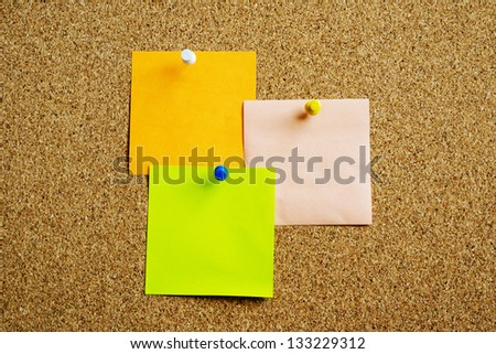 Three post it on cork board