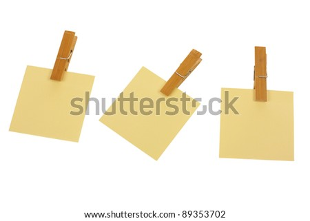 Three post it with pegs isolated on white background