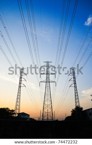 three  power towers with power lines with blue sky