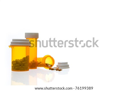 Three Prescription Medication Containers and Pills - stock photo