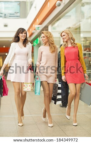 Three pretty friends in the shopping mall