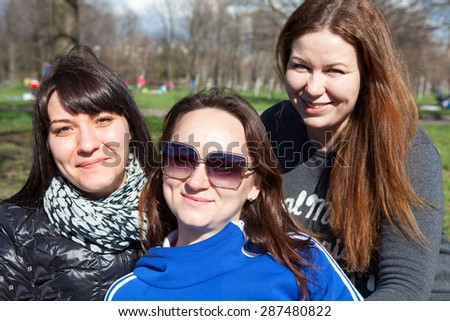 Three pretty girlfriends together - stock photo