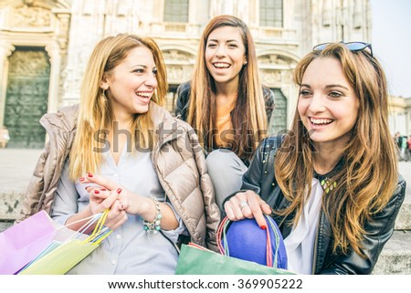 Three pretty woman laughing outdoors - Friends meeting in university and having fun - stock photo