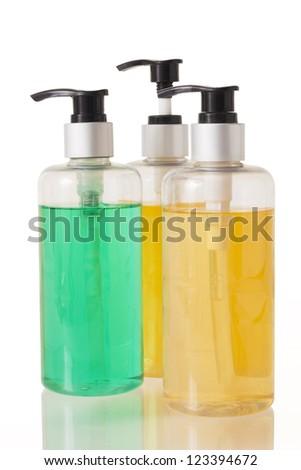 three pump bottles on white background. - stock photo