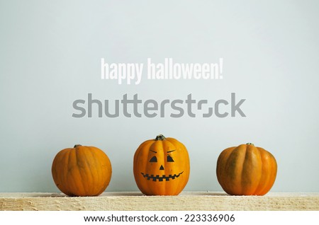 Three Pumpkins on Old  Wooden Background HAPPY HALLOWEEN - stock photo