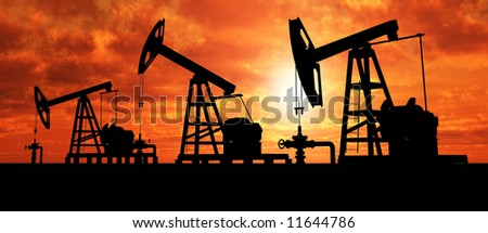 Three pumps over orange sky - stock photo