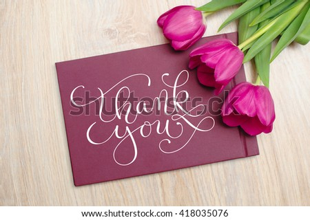 Three purple tulips and text thank you - stock photo