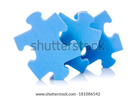 Three puzzle pieces with reflection on white background - stock photo