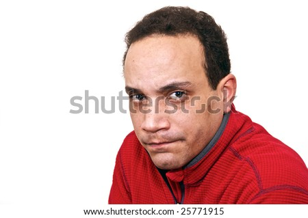 three quarter portrait of african american male wearing red shirt against white background looking mad or angry