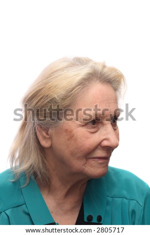 Three-quarter portrait of elderly woman in blue blouse, isolated on white background - stock photo