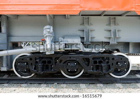 three railroad wagon wheels, view from side - stock photo