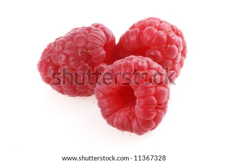 Three raspberries on a white background. - stock photo