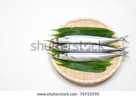 Three raw fish on the Colander - stock photo