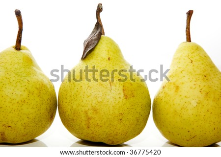 Three real-life pears on isolated white