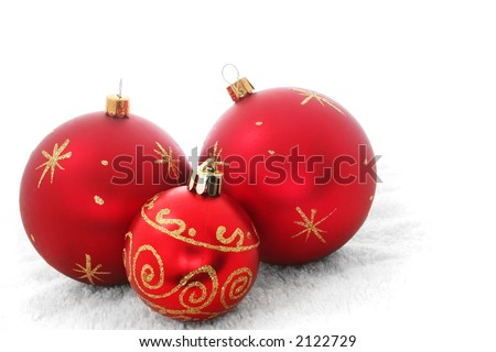 Three red baubles on a white background