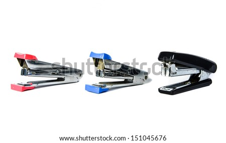 three red, blue and black stapler isolate on white backgrounds - stock photo
