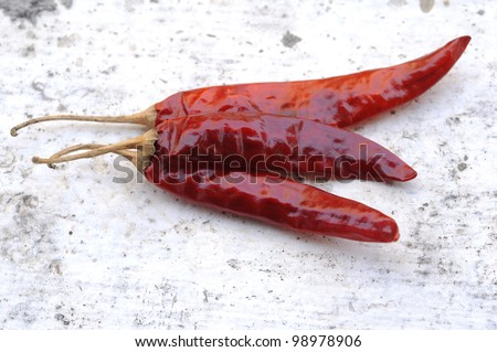 three red chili peppers isolated on the white