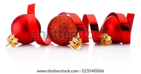 Three red Christmas baubles and curling paper isolated on white background