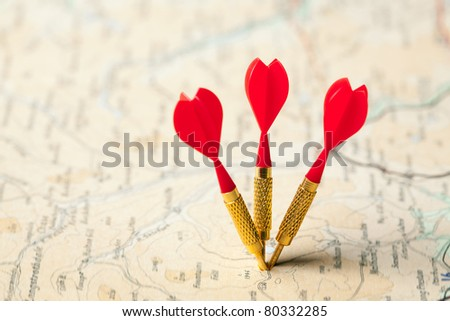 Three red darts in a shallow focus road map - stock photo