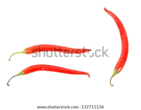 Three red hot chilli, or chili, peppers isolated on a white background used in cooking as a pungent seasoning and flavouring and as a dried spice - stock photo