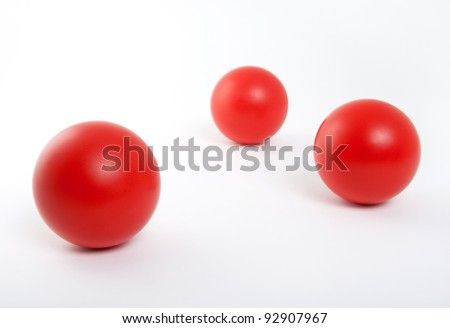 Three red rubber balls isolated on white background. - stock photo