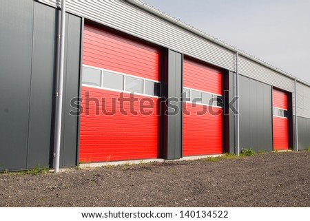 three red shed doors in a row - stock photo