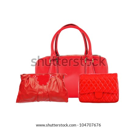 Three red women bags isolated on white background - stock photo