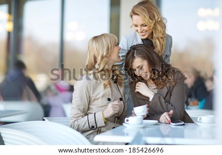 Three relaxed ladies at the coffee break - stock photo