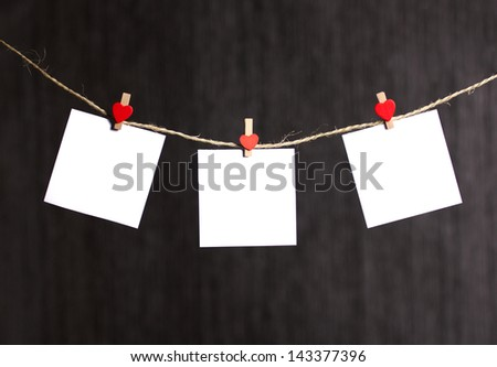three reminders note hanging with clothes pin on clothesline on grey dark background - stock photo