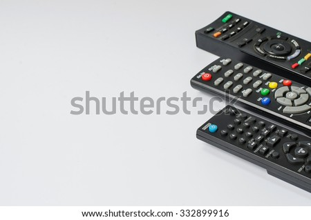 Three remote for control electrical power on white background - stock photo