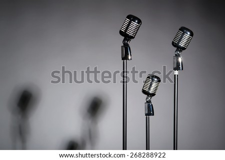 Three retro microphones with space for text - stock photo