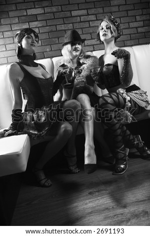 Three retro prime adult Caucasian females out on the town. - stock photo