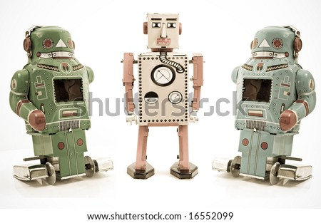 three retro robot toys - stock photo