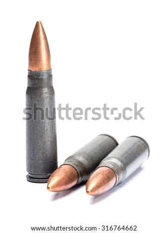 Three rifle bullets shot on white - stock photo