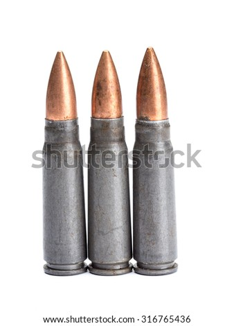 Three rifle bullets shot on white - stock photo