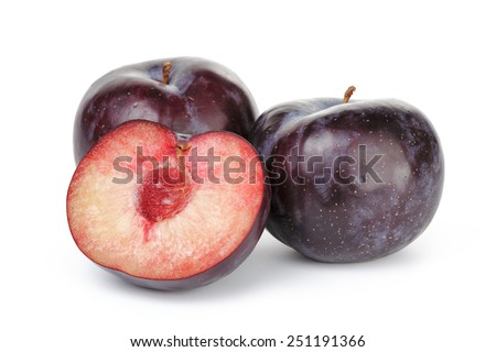 three ripe black plums isolated - stock photo