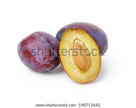 three ripe blue plums, isolated on white