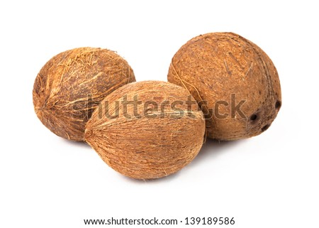 Three ripe coconuts isolated on white background. - stock photo
