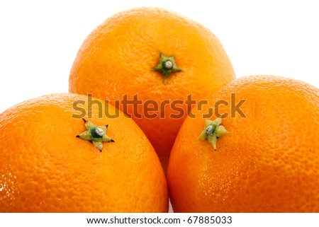 Three ripe  mandarins isolated on white background