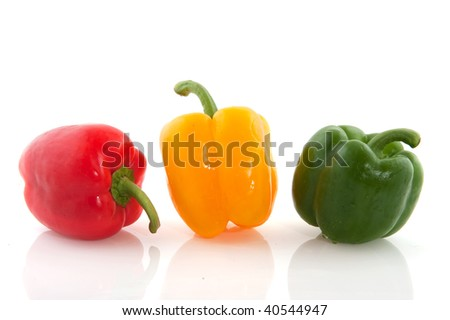Three ripe paprika in red green and yellow