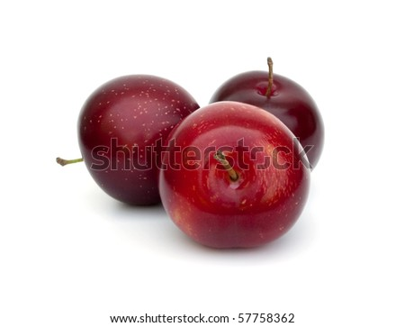 Three ripe plums - stock photo